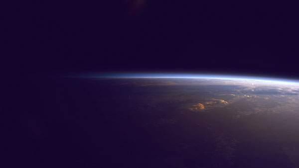 暗い宇宙に浮かびあがる地球