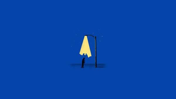 街灯の明かりをローラで消す男性