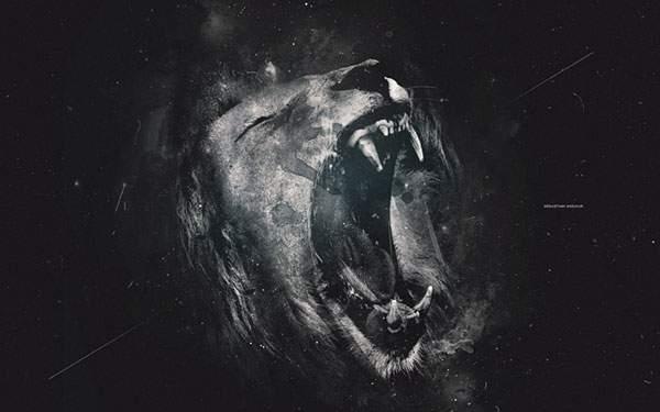 大きな口を開けて吠えるライオンの壁紙画像