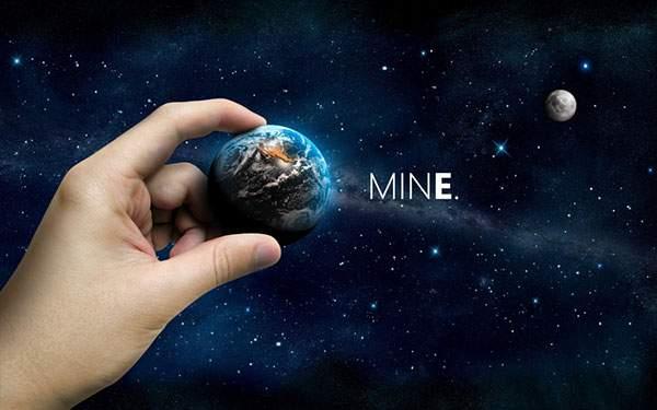 地球をつまむ手のグラフィックアート画像