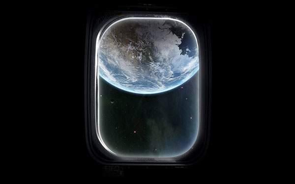 宇宙船の窓から覗く地球