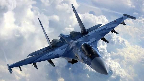 迫力のある青い戦闘機の壁紙画像