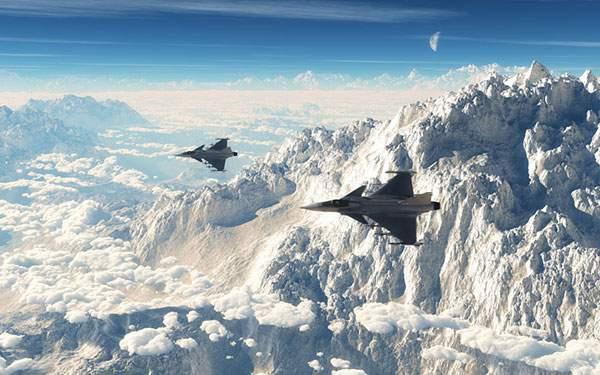 山と雲と2機の戦闘機