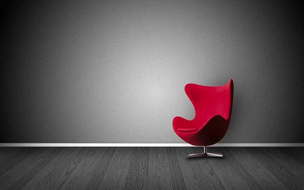 部屋の黒い背景に赤いエッグチェアが映える壁紙画像