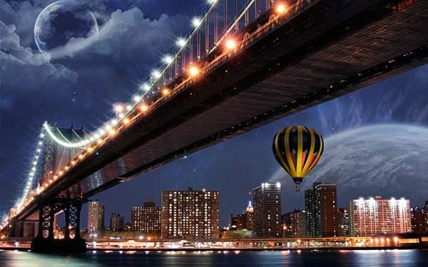 ライトアップされた橋や街と熱気球のロマンチックな壁紙画像