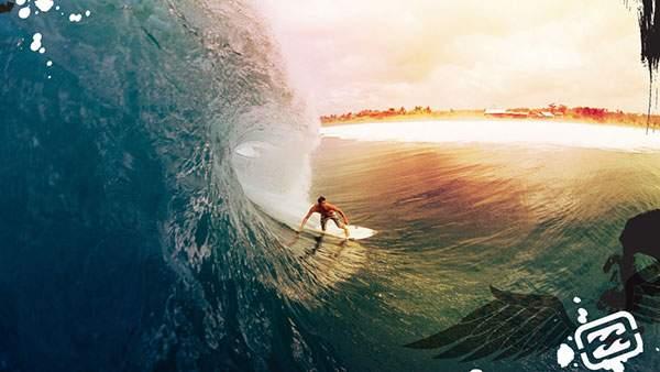 巨大な波を乗りこなすサーファーのクールな写真壁紙