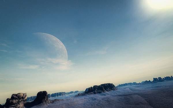 岩山のある景色と空にぼんやりと浮かぶ巨大な月のグラフィック画像