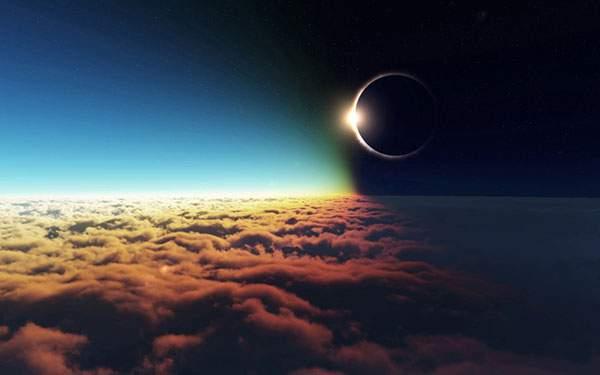 鮮やかな色に染まった雲と美しい皆既日食のグラフィックデザイン壁紙
