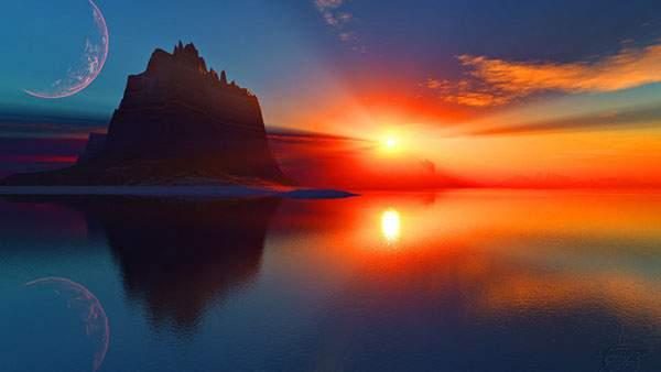 鮮やかな赤い夕日に染まった海辺の景色