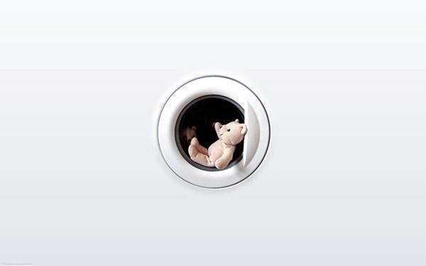 乾燥機から出るときに手を振るテディベアの可愛い写真壁紙