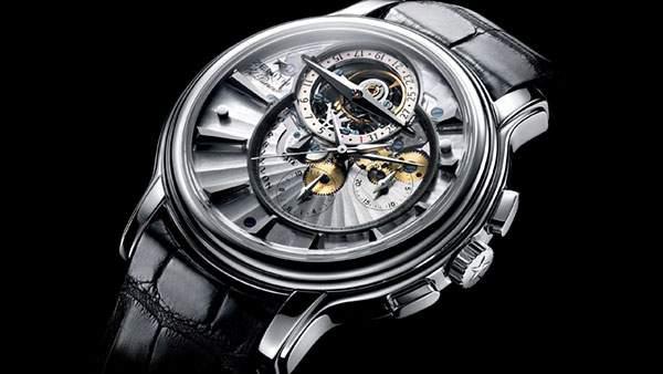 暗い背景に映えるシルバーの腕時計の高画質な壁紙画像