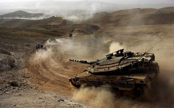荒れた大地を走る戦車を撮影した写真壁紙画像