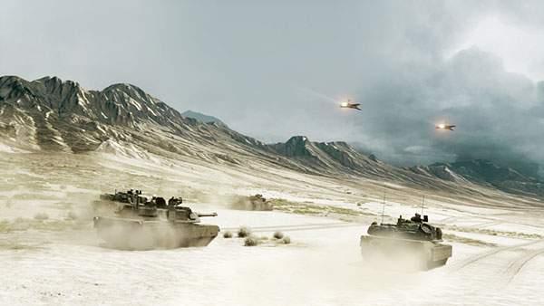 荒野を突き進む二台の戦車と戦闘機の写真壁紙
