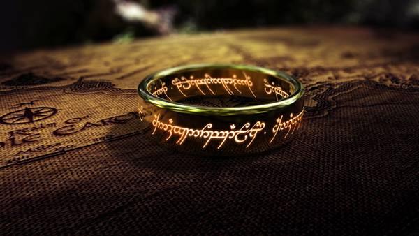 刻まれた文字が光るファンタジー風の指輪の写真壁紙画像