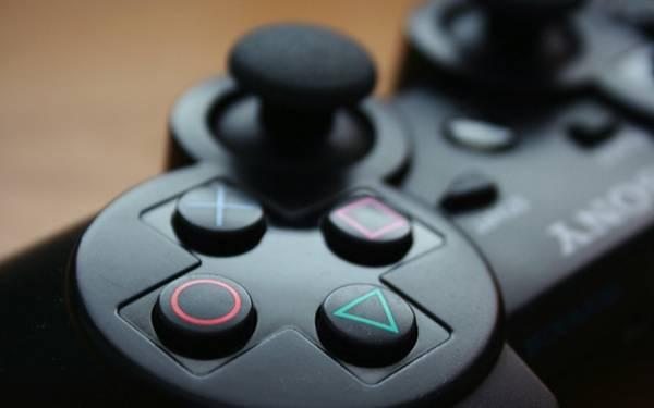 PSコントローラーのボタンをアップで撮影した写真壁紙画像