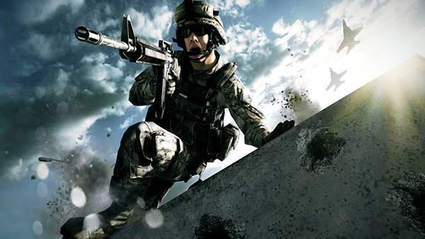 01.銃を構えながら塀を飛び越す軍人のかっこいい写真壁紙画像