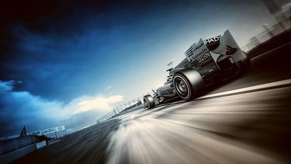 11.高速で駆け抜けるF1レーシングカーをローアングルで撮影したカッコイイ写真壁紙画像