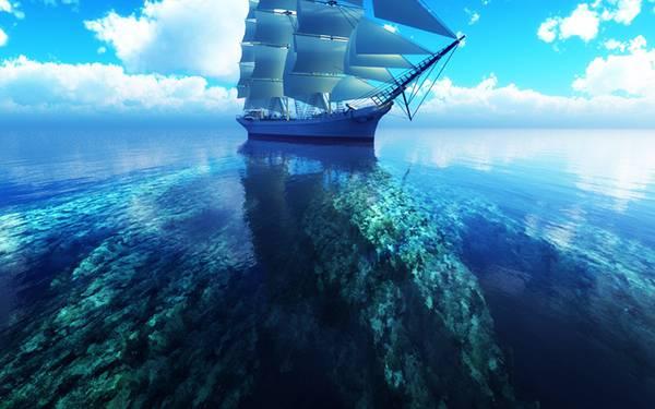 01.サンゴ礁と帆船を撮影した美しい写真壁紙画像