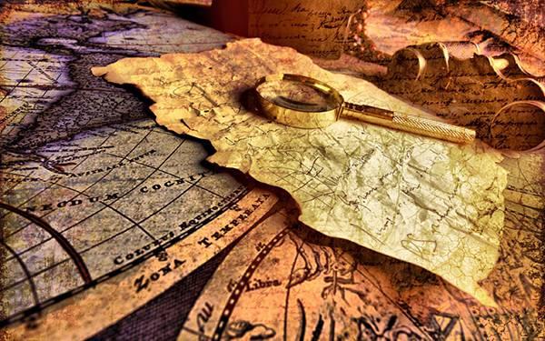 カラフルな世界地図とルーペを撮影した写真壁紙画像