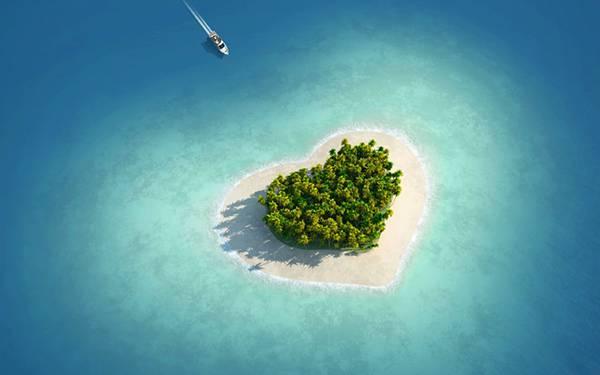 07.ハート型の無人島に向かうボートを上空から撮影した可愛い写真壁紙画像
