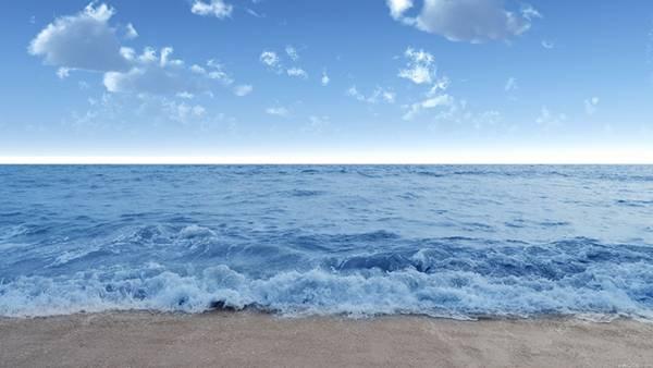 06.砂浜に打ち寄せる波と水平線の高解像度な写真壁紙画像
