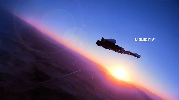 03.夕焼けの中のスカイダイバーを撮影した美しい写真壁紙画像