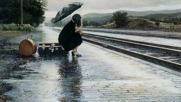 雨の中電車をまつ少女