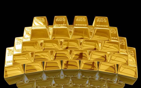 10.ずらっと積み重ねたゴールドバーを黒背景で撮影した写真壁紙画像