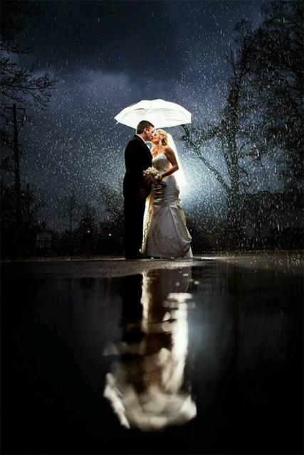 悪天候の中撮影された美しいウェディングフォト - 03