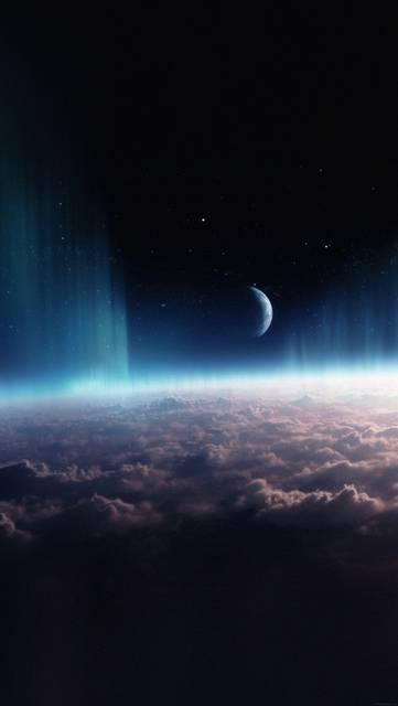宇宙から見た雲とオーロラと月