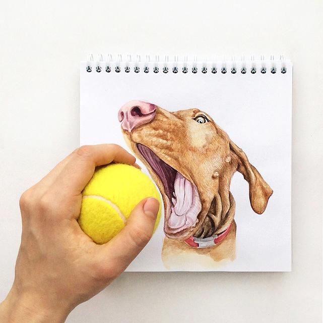 スケッチブックの中の犬と遊ぶイラストレーター - 01