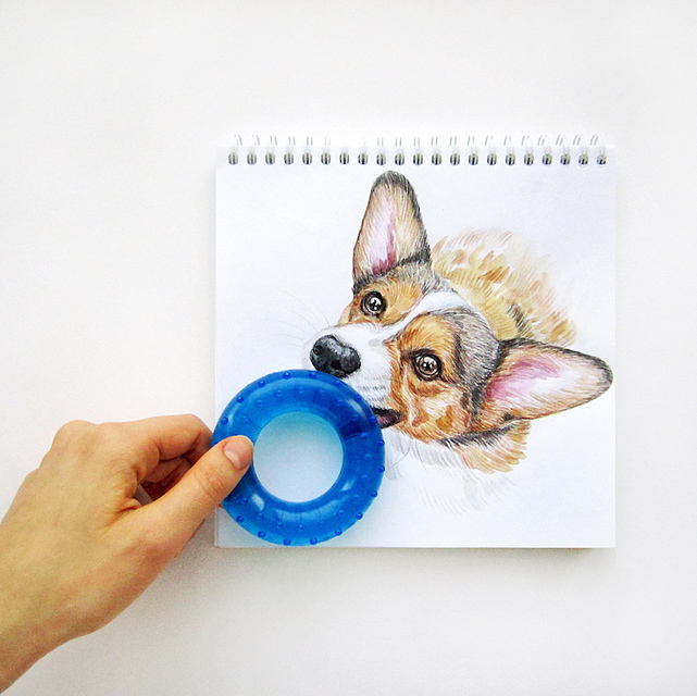 スケッチブックの中の犬と遊ぶイラストレーター - 05