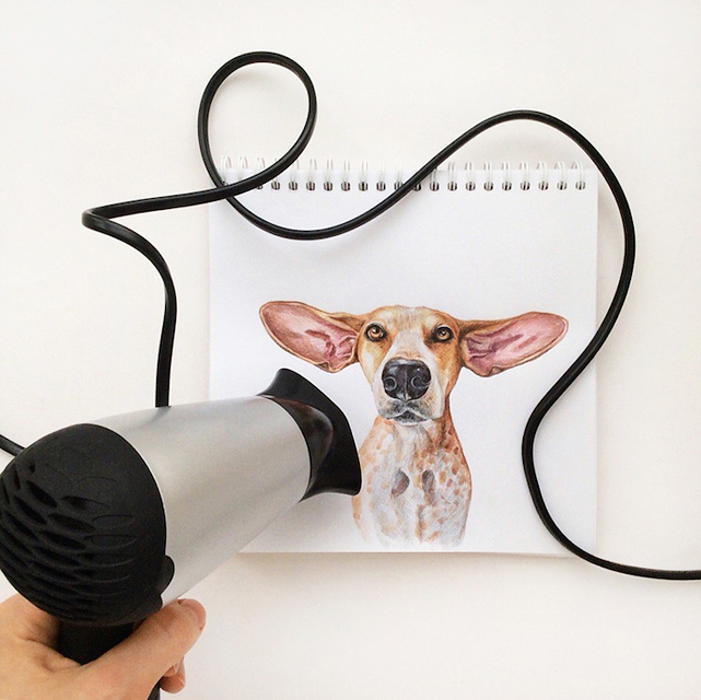 スケッチブックの中の犬と遊ぶイラストレーター - 09